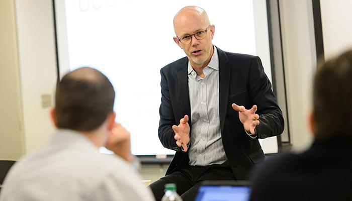 Professor Timothy Folta addresses a class